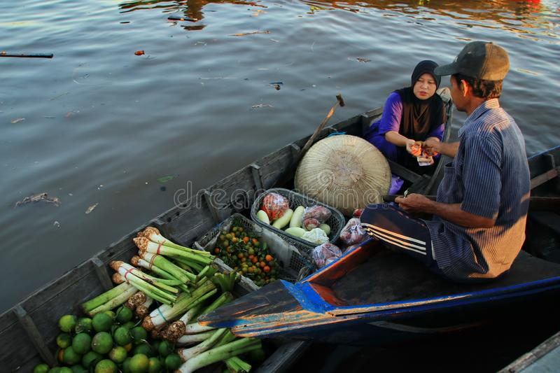 Barito river floating market in the morning. Citra Bahari Barito river floating market in the morning, full of gold from the sunrise in Banjarmasin / South stock image