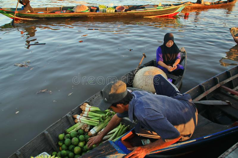 Barito river floating market in the morning. Citra Bahari Barito river floating market in the morning, full of gold from the sunrise in Banjarmasin / South stock images