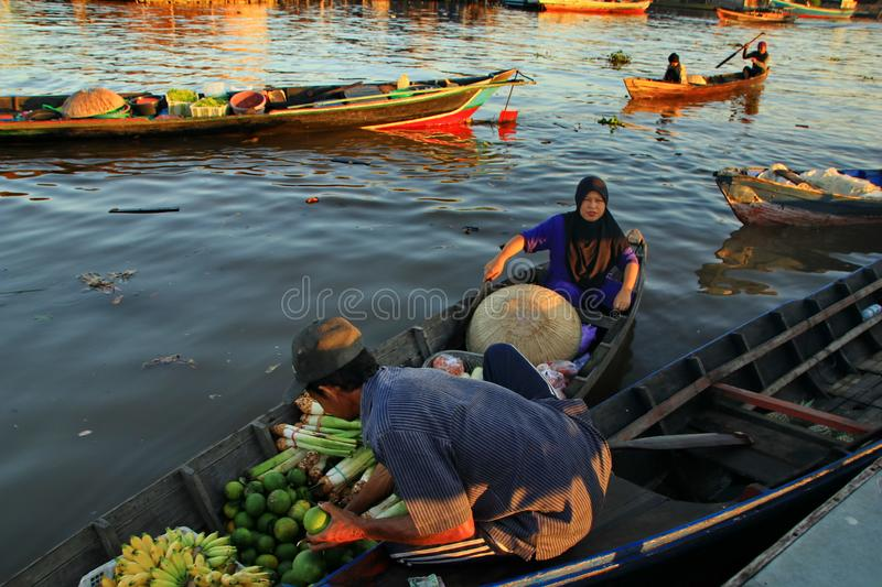 Barito river floating market in the morning. Citra Bahari Barito river floating market in the morning, full of gold from the sunrise in Banjarmasin / South royalty free stock photos