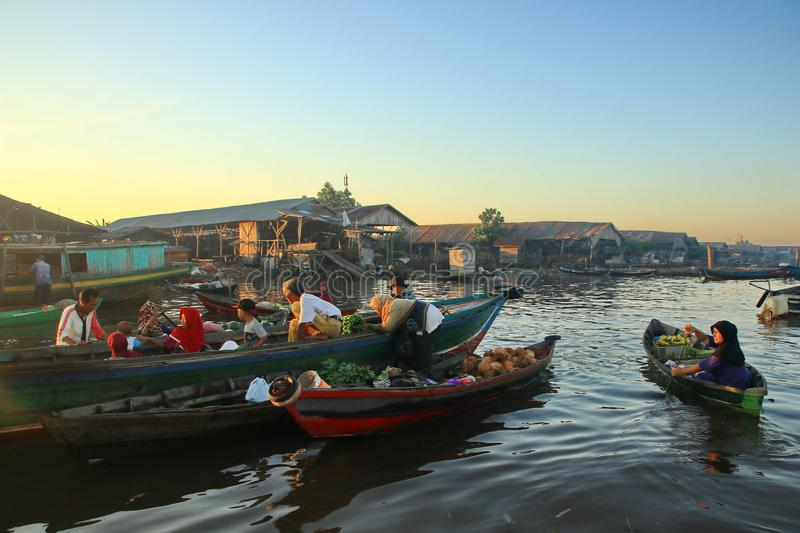 Barito river floating market in the morning. Citra Bahari Barito river floating market in the morning, full of gold from the sunrise in Banjarmasin / South stock photo
