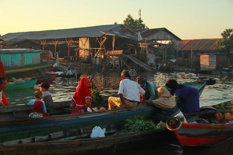 Barito river floating market in the morning. Citra Bahari Barito river floating market in the morning, full of gold from the sunrise in Banjarmasin / South royalty free stock photo