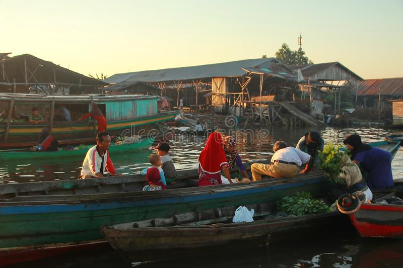 Barito river floating market in the morning. Citra Bahari Barito river floating market in the morning, full of gold from the sunrise in Banjarmasin / South royalty free stock photography