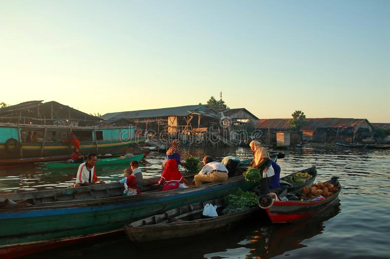 Barito river floating market in the morning. Citra Bahari Barito river floating market in the morning, full of gold from the sunrise in Banjarmasin / South royalty free stock image