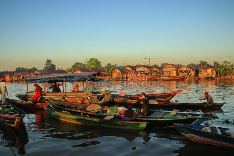 Barito river floating market in the morning. Citra Bahari Barito river floating market in the morning, full of gold from the sunrise in Banjarmasin / South stock photos