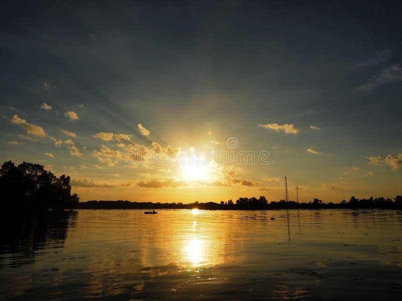 Barito river. Water sun morning sunrise sky skyblue cloud dark replaction nature landscape stock image