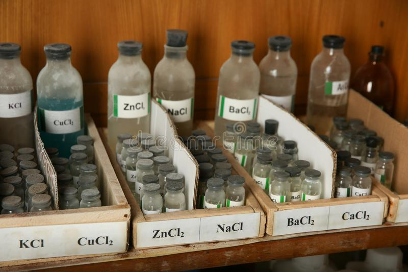 Barium chloride, Calcium chloride, sodium chloride are in the bottles. Bottles with reagents of BaCl2, CaCl2, NaCl on the shelf of the chemical cabinet. Barium stock photography
