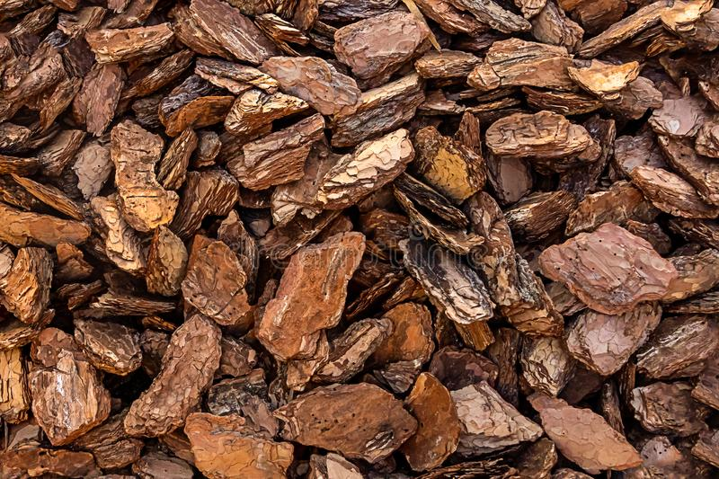 Bark crushed wood brown natural background wooden crisps decor mulch background rustic eco fertilizer royalty free stock photos