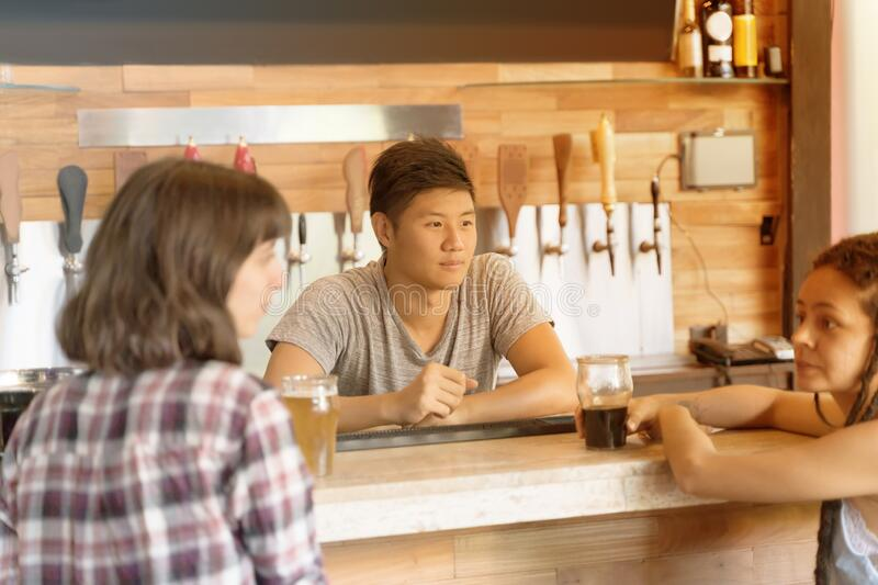 Barkeeper serving customers stock image