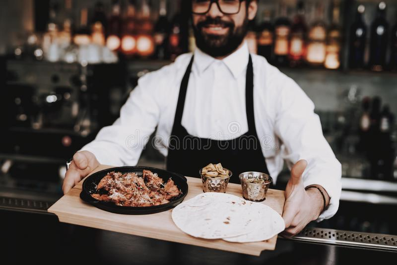 Barman. Food to Customers `. Snack. Young People. stock photography