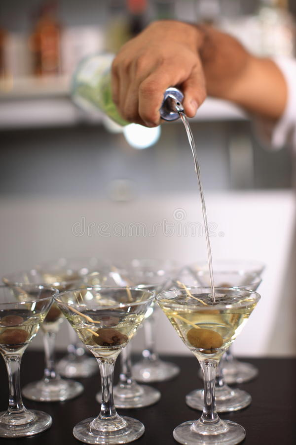 Barman pours martini royalty free stock photography