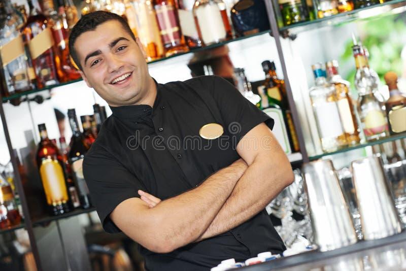Barman worker standing at bartender desk stock image