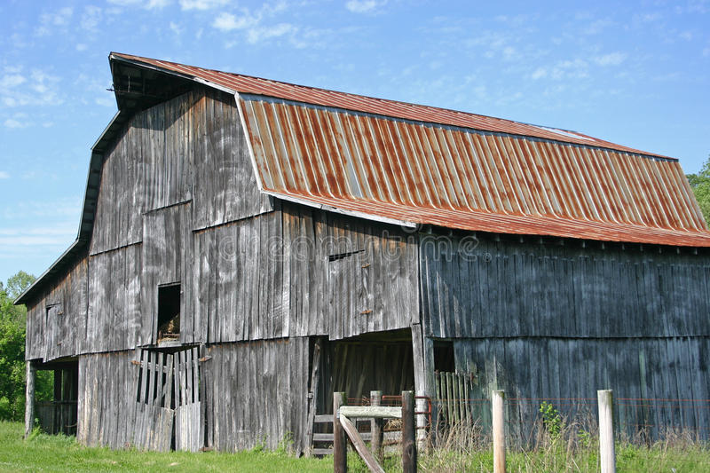 Barn. An old barn with a rusty roof, near Lynchburg, Tennessee royalty free stock image