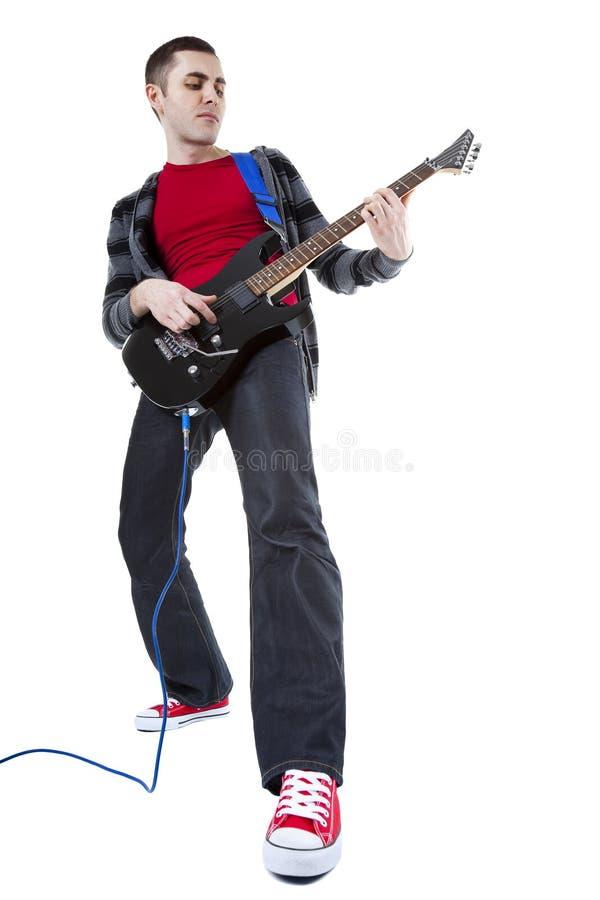 Barn bemannar den leka gitarren över vitbakgrund royaltyfria bilder