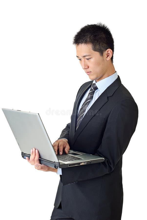 barn för affärsmanbärbar datorbruk royaltyfri foto