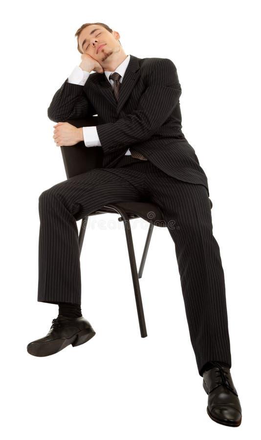 barn för dräkt för svart affärsch-man sittande arkivbild