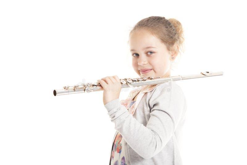 barn för flöjtflickaholding royaltyfri fotografi