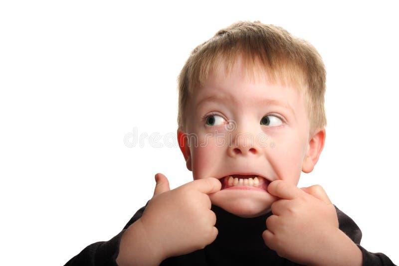 barn för gullig framsida för pojke roligt görande arkivbilder