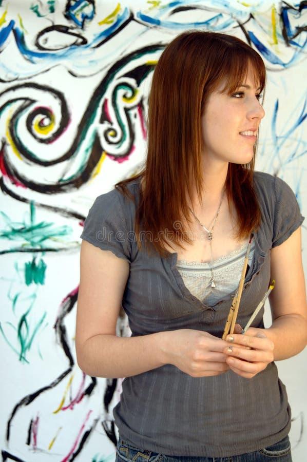 barn för konstnärkvinnligmålare arkivbilder