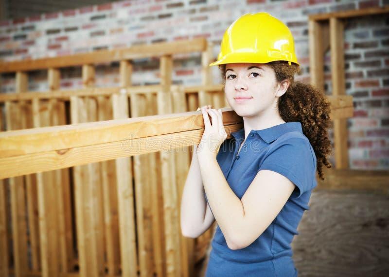 barn för konstruktionskvinnligarbetare royaltyfri foto