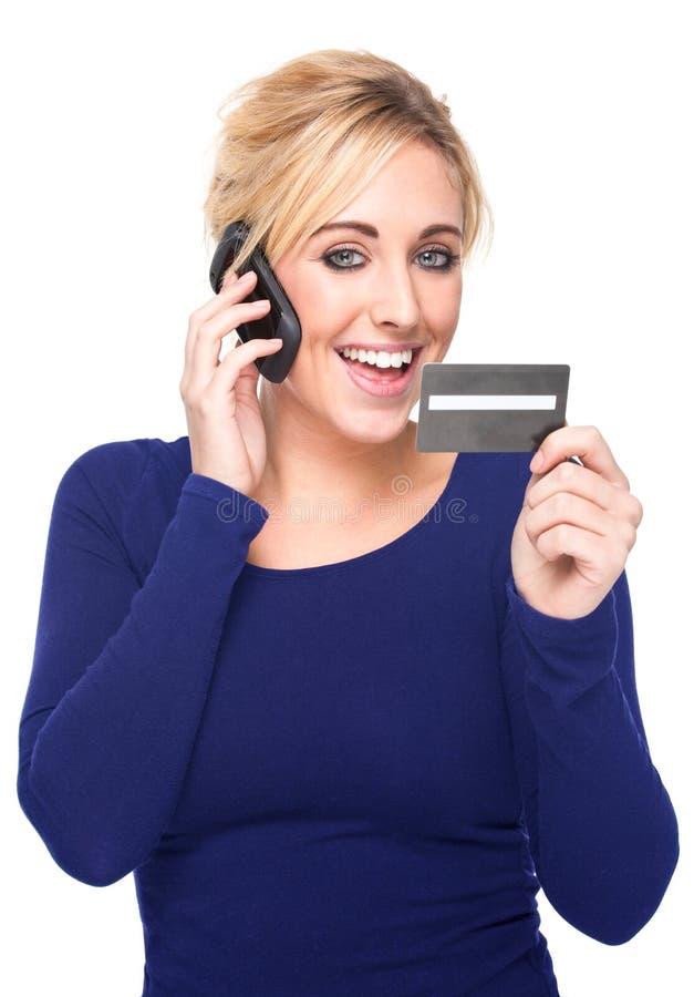 barn för kvinna för betalande telefon för kortcellkreditering royaltyfri bild