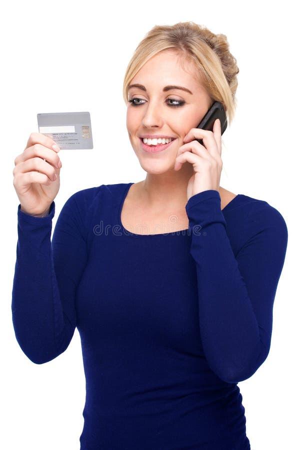 barn för kvinna för betalande telefon för kortcellkreditering arkivfoto