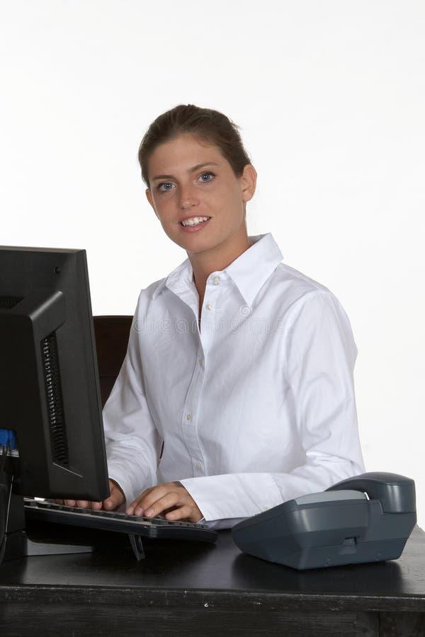 barn för kvinna för datorskrivbordtelefon royaltyfri bild