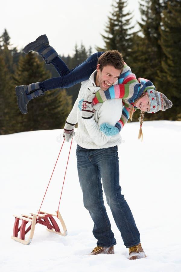 barn för snow för dotterfadersled royaltyfri fotografi