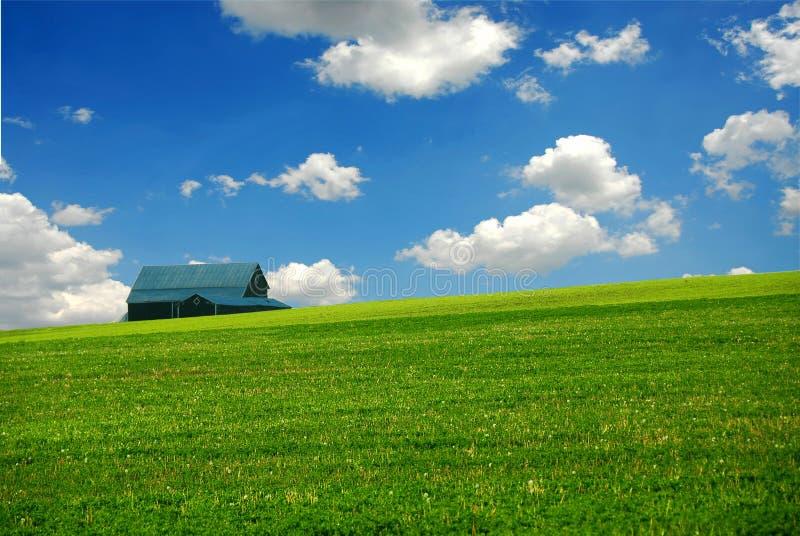 Barn in farm field royalty free stock image