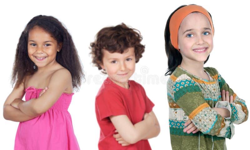 barn grupperar lyckligt arkivbild