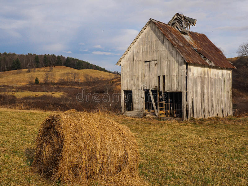 Barn and Hay Roll royalty free stock image