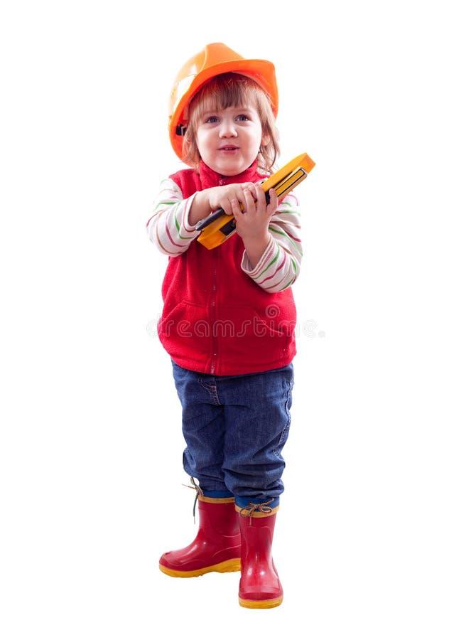 Barn i hardhat med hjälpmedel arkivfoto