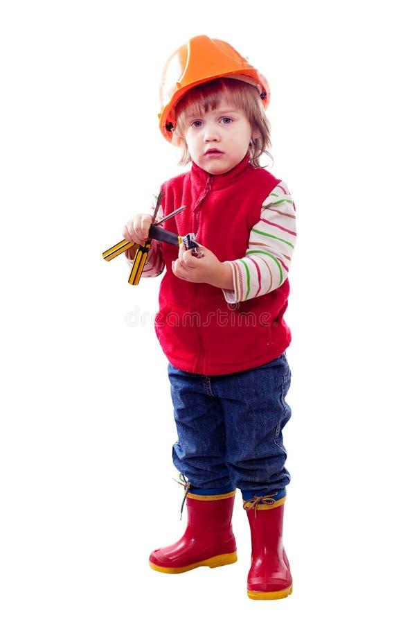 Barn i hardhat med hjälpmedel royaltyfria bilder