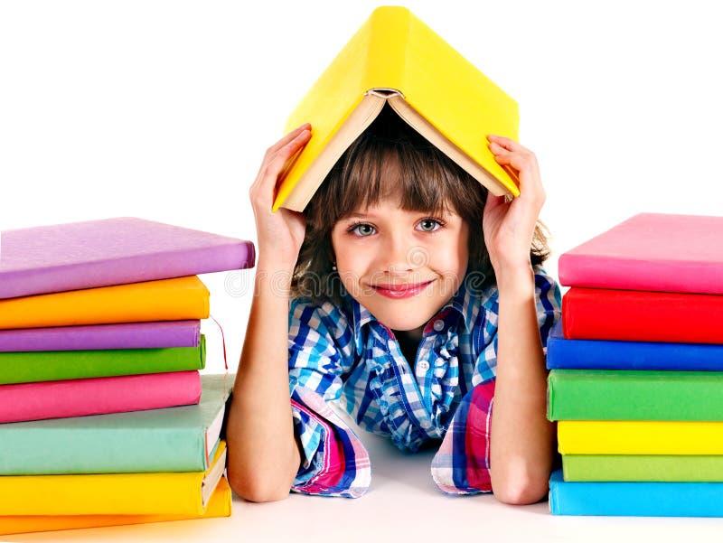 Barn med bunten av böcker. royaltyfria bilder