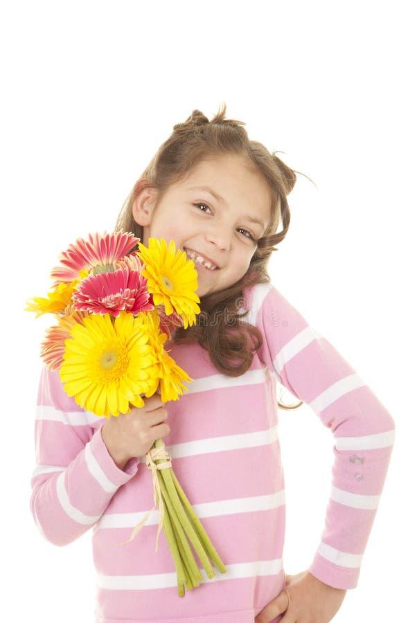 Barn med gruppen av blommor royaltyfria bilder
