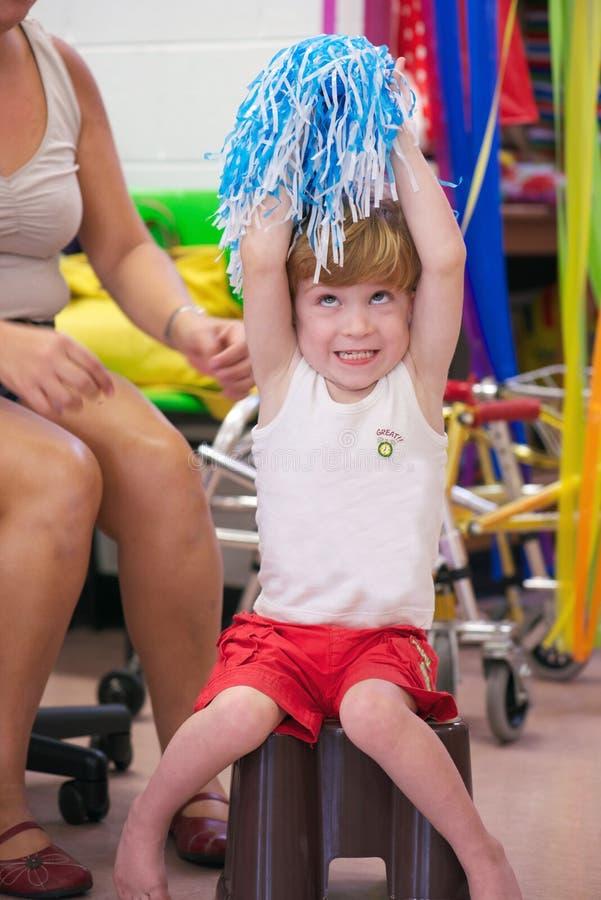 Barn med handikapp fotografering för bildbyråer