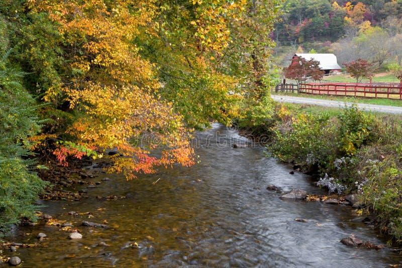 Barn and Mountain Creek stock photo