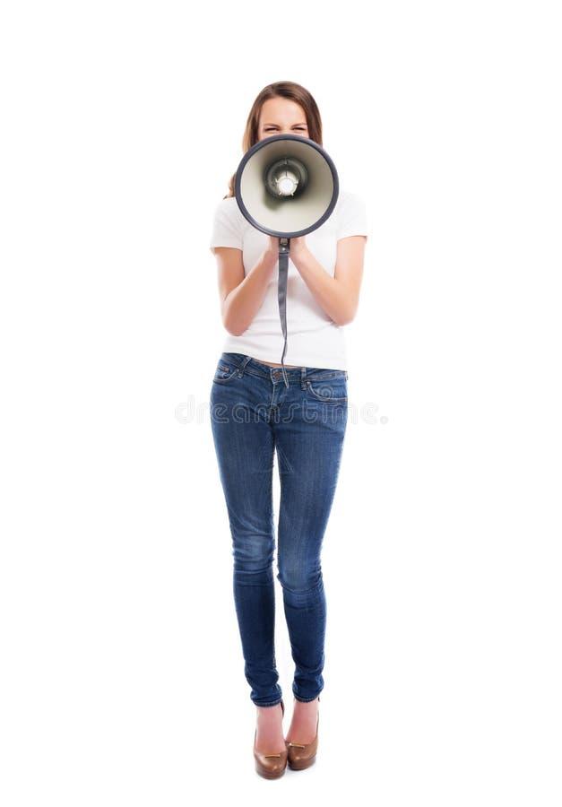 Barn och attraktiv Caucasian kvinna som skriker på megafonen royaltyfria foton