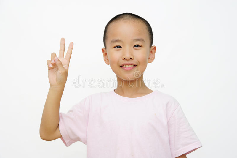 Barn och två fingrar royaltyfria foton