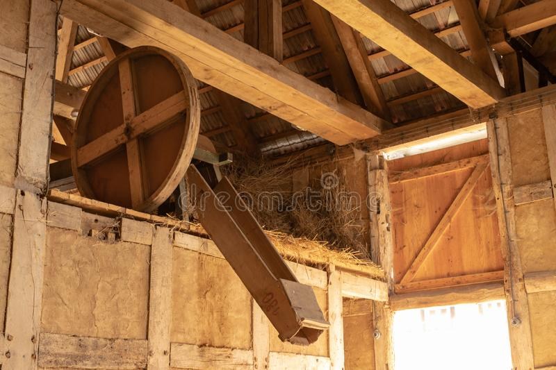 A barn in an old farm. Old machines helpful in agriculture. Season of the spring royalty free stock image