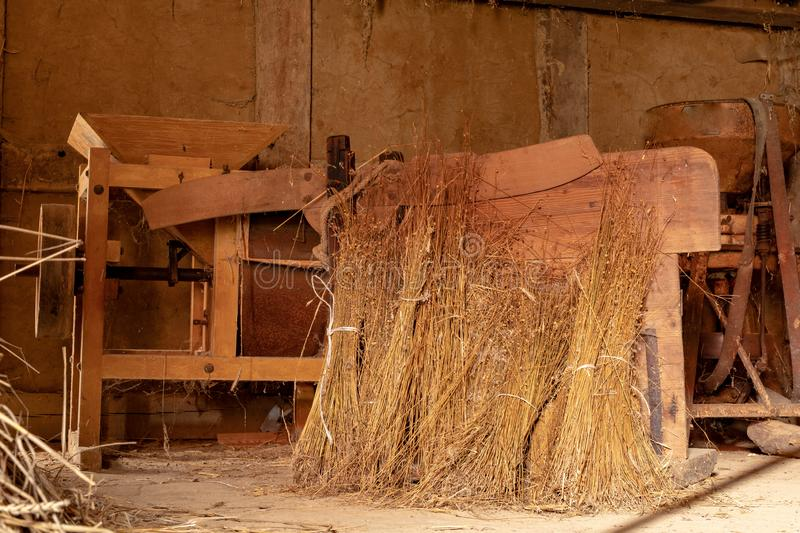 A barn in an old farm. Old machines helpful in agriculture. Season of the spring stock photos