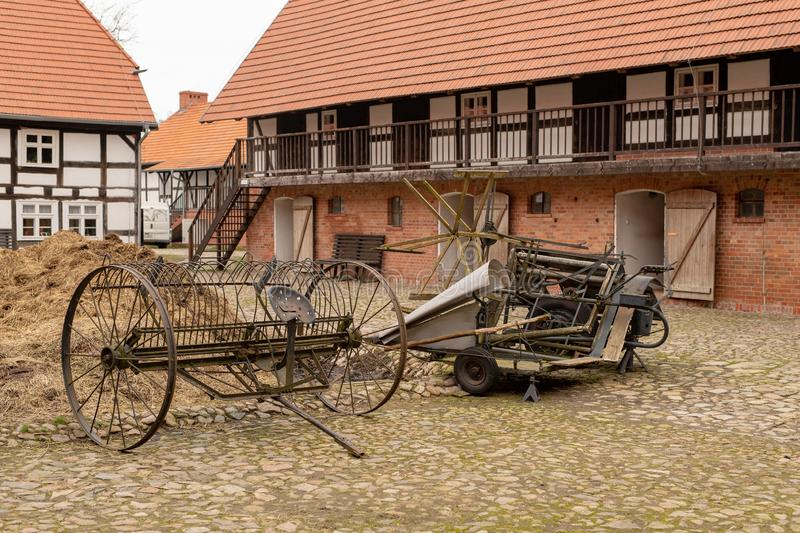 A barn in an old farm. Old machines helpful in agriculture. Season of the spring royalty free stock images