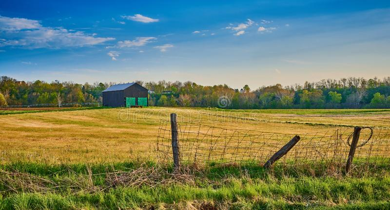 Barn with Old Wire Fence.  royalty free stock images
