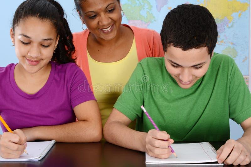 Barn på skolan arkivfoton