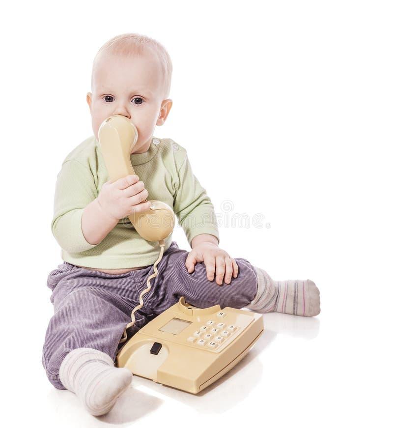 Barn på telefonen royaltyfri fotografi