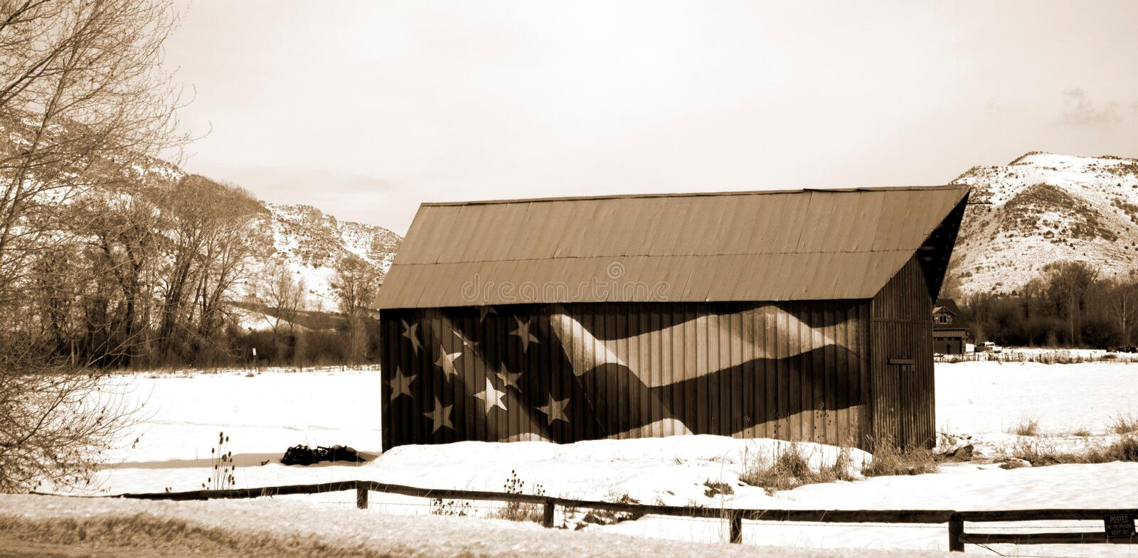Patriotic Barn in snowy moutains royalty free stock images