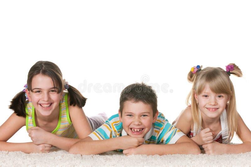 barn skämtsamma tre royaltyfria bilder