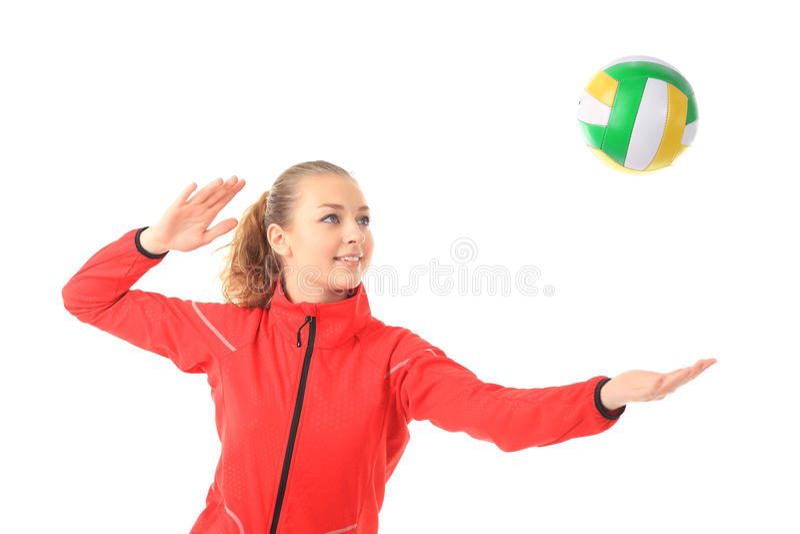 Barn skönhetvolleybollspelare. Isolerat på vit i studio royaltyfri foto