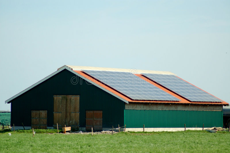 Barn with solar cells royalty free stock photo