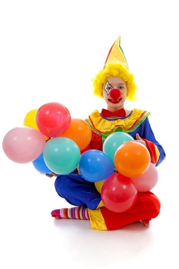 Barn som kläs som färgrik rolig clown royaltyfria foton