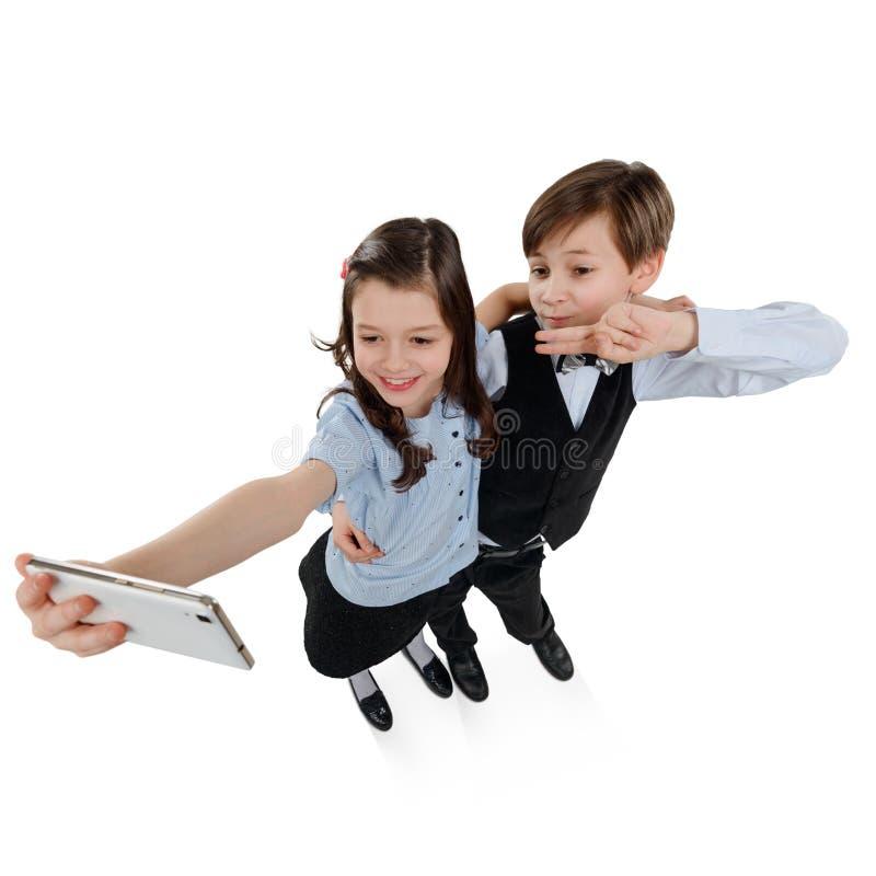 Barn som tar en selfie arkivfoto